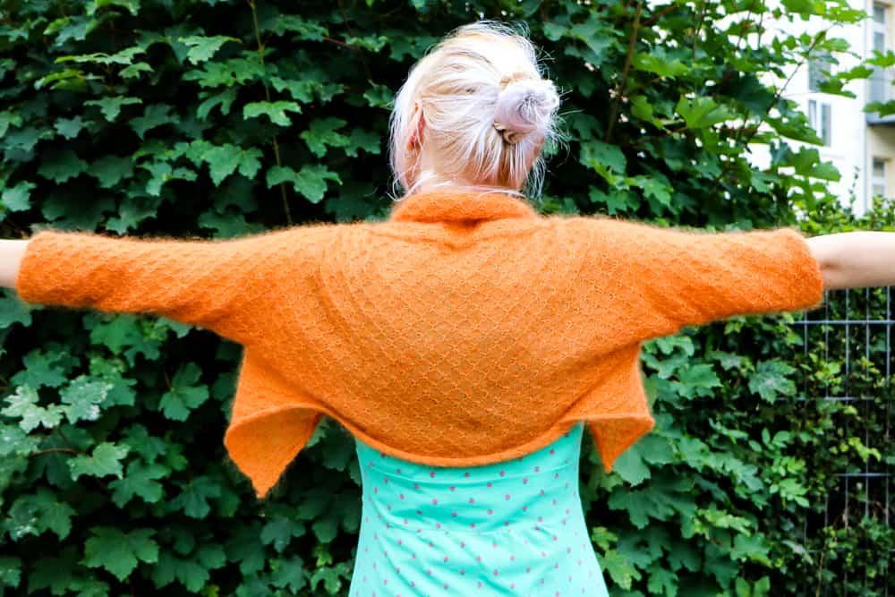 Wende-Bolero orange kurz von hinten